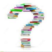 Znak zapytania ułożony w pionie z książek.